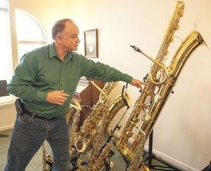 Tim Price talks about his contrabass saxophone. Dean Hare/Daily News